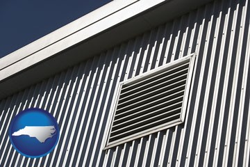 metal-clad building architectural details - with North Carolina icon